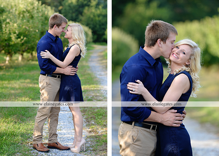 mechanicsburg-central-pa-engagement-portrait-photographer-outdoor-couple-orchard-road-path-trees-holding-hands-kiss-hug-love-barn-field-wildflowers-ls-02