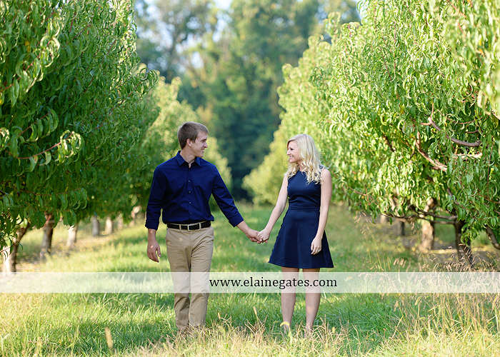 mechanicsburg-central-pa-engagement-portrait-photographer-outdoor-couple-orchard-road-path-trees-holding-hands-kiss-hug-love-barn-field-wildflowers-ls-03